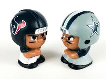Texans and Cowboys Li`l Teammates figures. Houston Texans and Dallas Cowboys Li`l Teammates figures on a white backdrop Royalty Free Stock Images