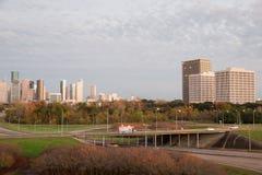 Houston Texas Mid town skyline. Cloudy sky near sunset Stock Images