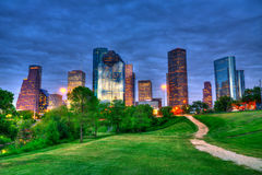Houston Texas modern skyline at sunset twilight from park. Lawn Royalty Free Stock Image