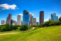 Houston Texas Skyline modern skyscapers and  blue sky. Houston Texas Skyline with modern skyscapers and blue sky view from park lawn Stock Images