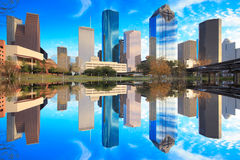Houston Texas Skyline with modern skyscrapers and blue sky view. From park with reflection