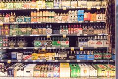 Imported beers at Whole Foods store. HOUSTON, TEXAS, US - DEC 9, 2017: Various bottles of craft, microbrews, IPAs imported beers from around the world on shelf royalty free stock image