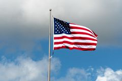 Houston, Texas USA - June 15: American flag fluttering in the wind. The US flag fluttering in the wind with clouds in the background stock photos