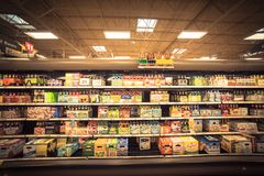 Various selection of beer bottles on display at supermarket. HOUSTON, TX, US - JUL 3, 2017:Wide selection of domestic and imported beer at grocery store open Royalty Free Stock Image