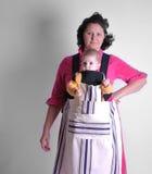 Houswife com ajudante novo Imagem de Stock Royalty Free