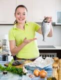 Houswife cooking dorada fish Royalty Free Stock Photos
