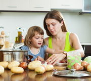 Houswife with girl cooking Royalty Free Stock Photo