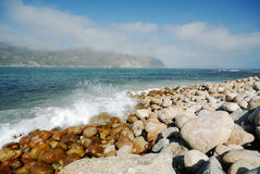 Hout Bay. Waves crashing into Hout Bay - Cape Town Stock Photo