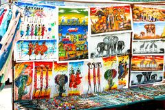 HOUT BAY, CAPE TOWN, SOUTH AFRICA - DECEMBER 24, 2017: Traditional african paintings, handmade accessories and souvenirs at local stock image