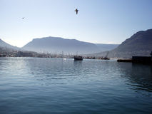 Hout Bay in Dreamy Blue. Hout Bay harbour, Cape Town, South Africa Stock Photos