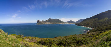 Hout Bay panorama with a few clouds. Hout Bay panorama with blue skies and a few clouds stock photo