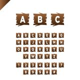 Houten alfabetblokken met letters en getallen op houten textuurgebied ABC-doopvont voor uw tekstbericht, titel of emblemenontwerp Stock Foto's
