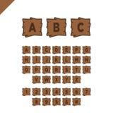 Houten alfabetblokken met letters en getallen op houten textuurgebied met overzicht ABC-doopvont voor uw tekstbericht, titel of e Stock Foto's