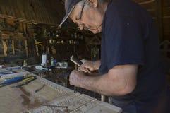 Houten beeldhouwer stock afbeelding
