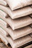 Houten biomassa in plastic zakken Stock Fotografie