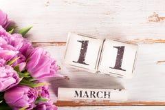 Houten Blok met de Datum van de Moedersdag, 11 Maart Stock Foto