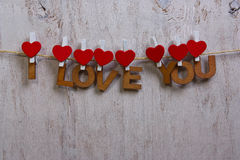Houten brieven en hart die uitdrukking I vormen LIEFDE U Royalty-vrije Stock Foto's