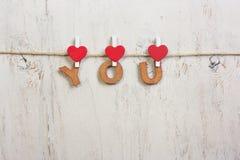 Houten brieven en hart die uitdrukking vormen U Royalty-vrije Stock Fotografie