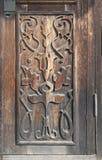 Houten carvingon de oude deur Stock Foto
