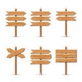 Houten de raadsreeks van pijltekens De vector houten weg van de uithangbordenplank Royalty-vrije Stock Foto's