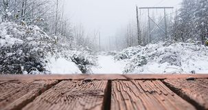 Houten dek en sneeuw 4k stock video