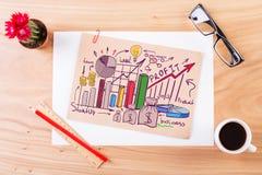 Houten Desktop met bedrijfsschets Stock Foto's