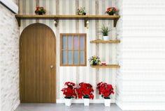 Houten deur, plank en bloem voor modelbinnenland Stock Foto
