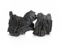 Houten die houtskool op witte achtergrond wordt geïsoleerd Stock Foto