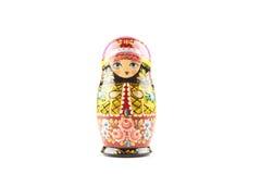Houten die matryoshkapop in Russische ornamenten wordt geschilderd in traditionele stijl Stock Foto's