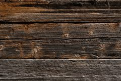 Houten donkere bruine planking achtergrond met barsten en spleten royalty-vrije stock afbeelding