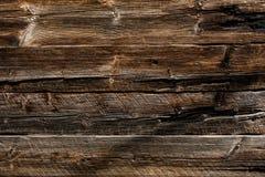 Houten donkere grijze en bruine planking achtergrond met barsten en spleten royalty-vrije stock foto's