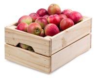 Houten dooshoogtepunt van verse die appelen op een wit wordt geïsoleerd Royalty-vrije Stock Foto
