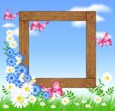 Houten fotoframes met bloemen en vlinder Royalty-vrije Stock Foto's