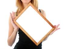 Houten frame in handen Stock Afbeeldingen