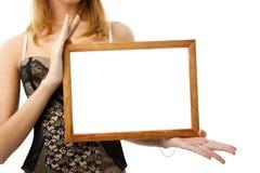 Houten frame in handen Royalty-vrije Stock Afbeeldingen