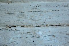 Houten grijze langzaam verdwenen logboekenachtergrond met gebreken en spleten stock foto