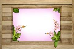 Houten groetkader met orchideeën Stock Afbeeldingen