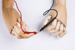 Houten Hand en elektrische multimeter stock afbeeldingen