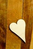 Houten hart op bruin Royalty-vrije Stock Foto's