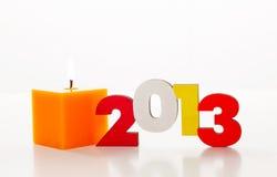 Houten het jaaraantal van 2013 met een brandende kaars Stock Foto's