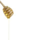 Houten honing drizzler met een honing. Stock Foto's
