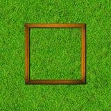 Houten kader op groen grasgebied royalty-vrije stock afbeelding