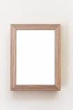 Houten kader op witte muur Stock Fotografie