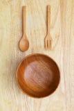 Houten kom met vork en lepel Stock Foto's