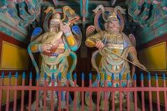 Houten Koreaanse Beschermerbeeldhouwwerken in Bulguksa-Tempel Royalty-vrije Stock Foto's