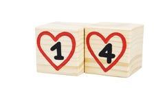 Houten kubussen met met de hand geschreven en vier binnen rode harten Stock Afbeelding