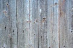 Houten langzaam verdwenen grijze planking achtergrond met barsten en spleten royalty-vrije stock foto's