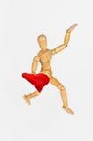 Houten ledenpop met hart Stock Afbeelding