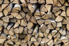 Houten logboeken, stralen, brandhout, kader Heel wat hout Houten logboek houten achtergrond brandstof Het oogsten van brandhout v stock afbeelding