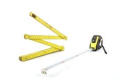 Houten meter en het meten van band stock afbeelding